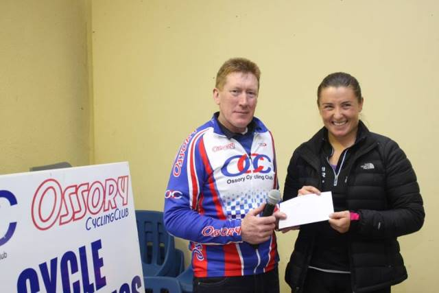 Eimear Moran is presented with her prize by Ossory CC