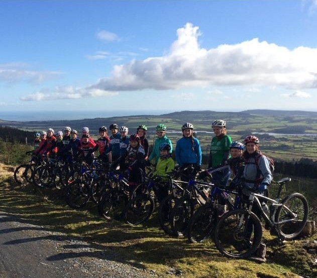 The mid-term Training Camp group line up at scenic Ballinastoe Wood