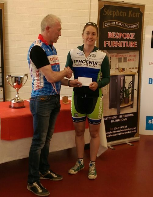 Claire McIlwaine, Phoenix CC, receives her prize for victory in National League Round 4